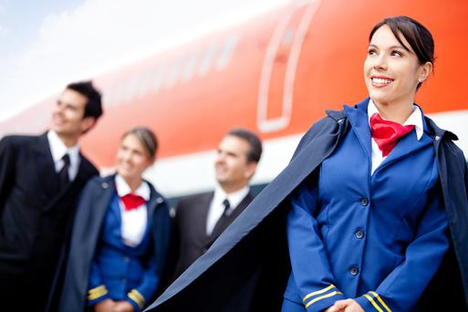 Flight attendant with cabin crew and an airplane