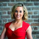 RTE broadcaster Lady in Red Kathryn Thomas issues a #RedAlert to women to know the risks of heart disease and stroke at the CHQ Building, IFSC