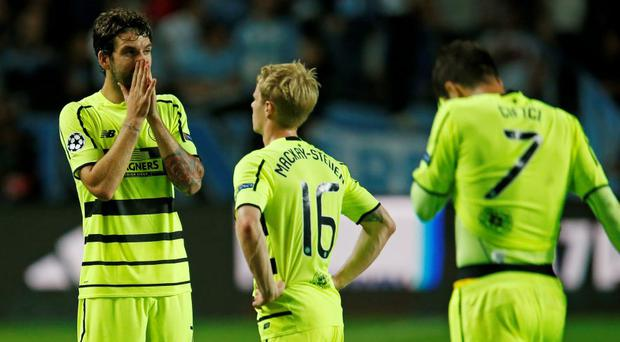 Celtic's Charlie Mulgrew looks dejected after defeat to Malmo