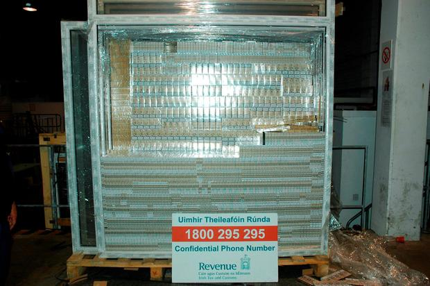 Eight million black cigarettes elaborately hidden within window frames arriving off a boat from Rotterdam which was found by sniffer dog Casey at Dublin Port Credit: Revenue Customs Service/PA Wire