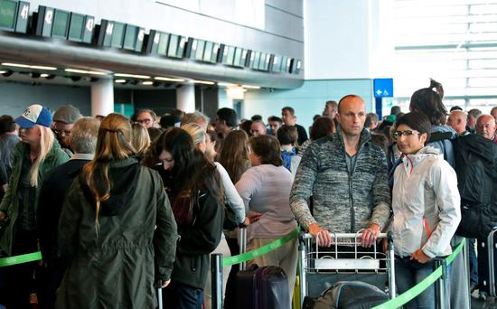 Passengers waiting to board flights at Dublin Airport yesterday. Photo: Colin Keegan