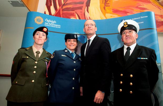Minister Simon Coveney with, from left, Army Corporal Sheila Scorr, Air Corps Corporal Joanne Woods and CPO Paul Nolan of the Naval Service at Dublin Castle yesterday. Photo: Tom Burke