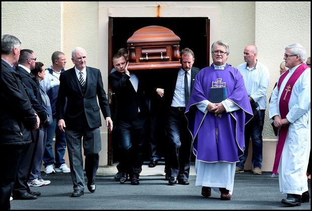 Jason Corbett's remains are carried by David Lynch (front right) from Our Lady Queen of Peace Church in Janesboro, Limerick
