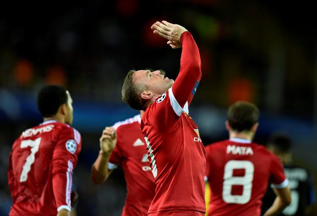 Manchester's Wayne Rooney celebrates after scoring the opening goal during the UEFA Champions League play-off round second leg football match between Club Brugge and Manchester United at Jan Breydel stadium in Bruges, Belgium on August 26, 2015. AFP PHOTO / JOHN THYSJOHN THYS/AFP/Getty Images