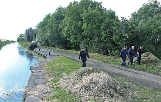 A garda search team searches along the canal between Bawnogue and Clondalkin in Dublin last night for missing Barry Corcoran