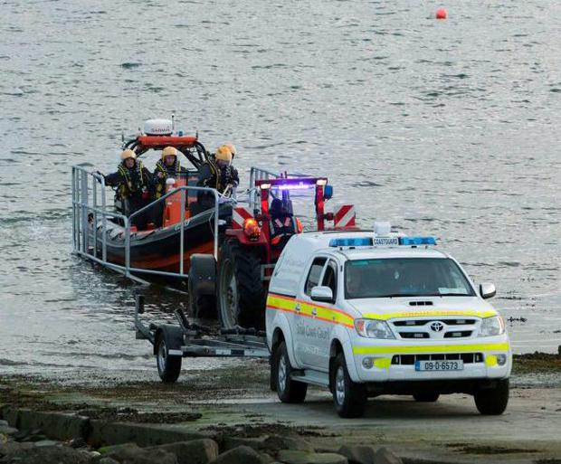 Members of the Coast Guard launch a search and rescue boat in an attempt to find the missing tourists Eiji Takagi and Ushio Azaki in Kilkee, Co Clare. Photo: Press 22
