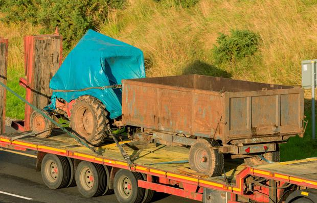 The tractor and trailer being taken away from the scene near Ballon, Co Carlow, where one brother died and another was left with serious injuries after an accident. Photo: Dylan Vaughan.