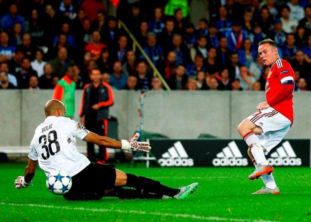 Wayne Rooney slots the ball into the net to complete a fairytale return to form in Brugge
