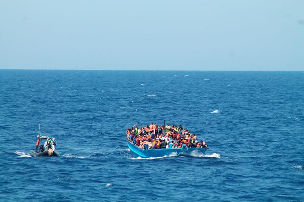 More than 700 migrants were onboard the 'fishing boat' Credit: Irish Defence Forces