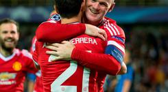 Manchester's Wayne Rooney (R) celebrates with his former teammate Ander Herrera