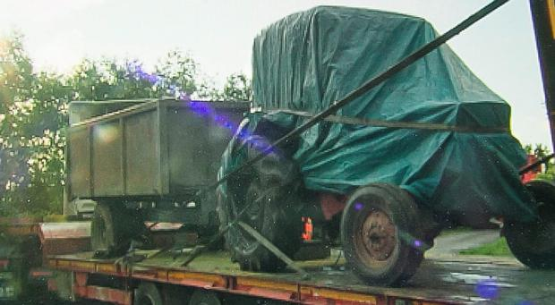 26/8/2015: The tractor and trailer being taken from the farm at Rathrush, near Ballon, Co Carlow. Photo: Pat Moore