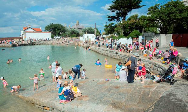 Crowds enjoy the good weather in Sandycove, Dublin. Photo: Gareth Chaney Collins