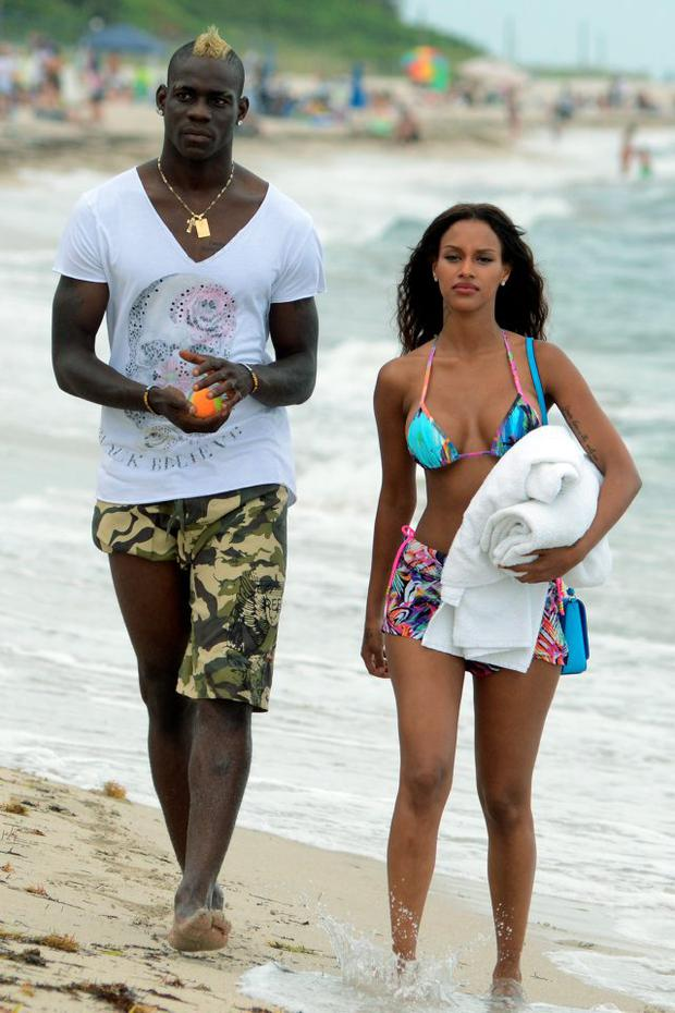 Mario Balotelli and Fanny Neguesha are seen on the beach in Miami Beach on July 6, 2014 in Miami, Florida. (Photo by Dave Lee/GC Images)