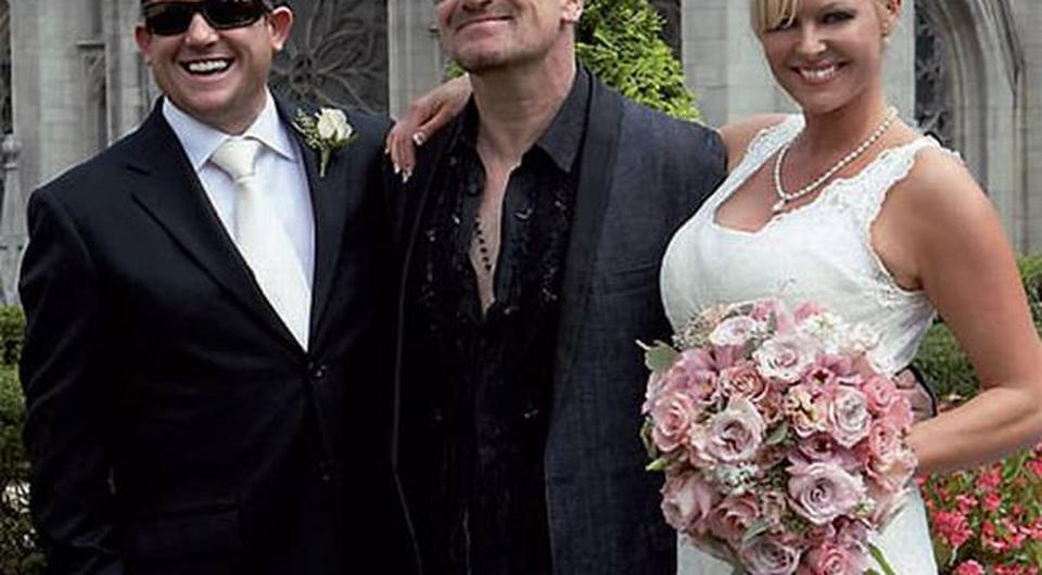 Amanda Brunker at her wedding with husband Philip McLaughlin (far left) and Bono (centre)