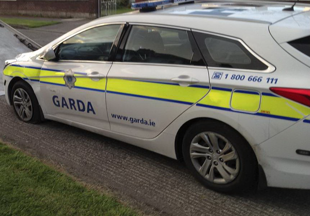 A garda car is taken away after being rammed in Glasnevin by bungling criminals