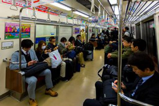 FUKUOKA, JAPAN - NOVEMBER 13: Train commuters in Fukuoka, Japan on November 13, 2013. Connected the city with Fukuoka airport, people can also use JR or subway for transportation in and out of the city