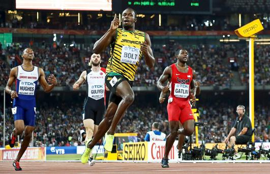 Usain Bolt crosses the finish line ahead of Justin Gatlin from the U.S. in the men's 200m final during the 15th IAAF World Championships at the National Stadium in Beijing