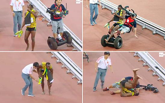 How Usain Bolt was taken out by a cameraman after winning 200m