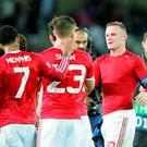 Wayne Rooney, right, Luke Shaw, centre, and Memphis Depay leave the pitch at the end of the Champions League play-off round