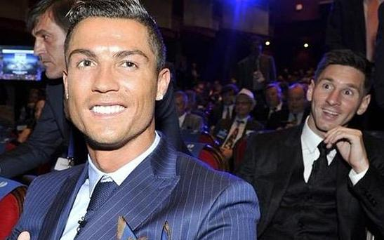 Lionel Messi photobombs Cristiano Ronaldo at the Champions League draw
