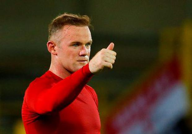 9bd4514ee Wayne Rooney gives the thumbs up after hitting a hat-trick in Brugge