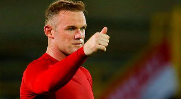 Wayne Rooney gives the thumbs up after hitting a hat-trick in Brugge