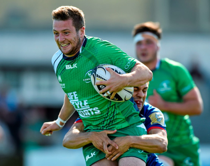 Connacht's Jack Carty is tackled by Grenoble's James Hart during their pre-season friendly