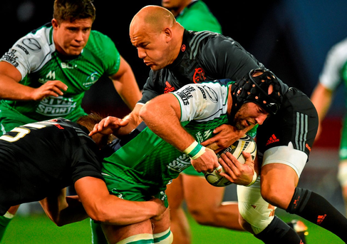 John Muldoon takes the attack to Munster's BJ Botha at Thomond Park