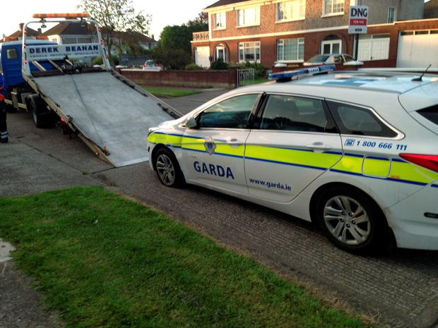 A damaged garda car at the scene of the stand-off