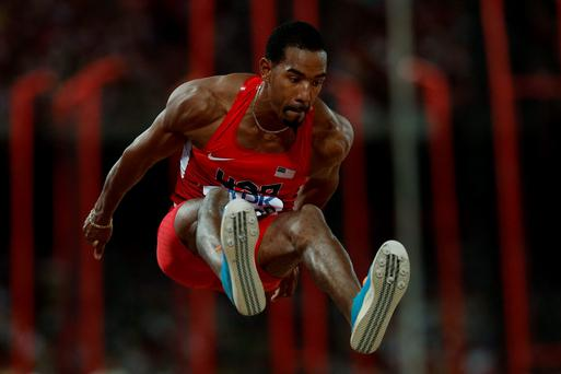 The USA's Christian Taylor is a picture of concentration as he leaps to World gold in the triple jump