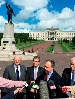 From left: senior DUP member William McCrea, DUP MP Jeffrey Donaldson, and the party's deputy leader, Nigel Dodds, outside Stormont House, Belfast, yesterday. Photo: PA