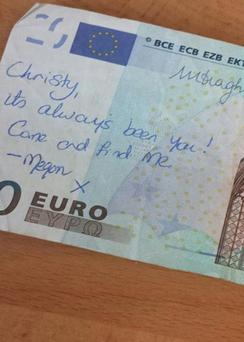 The heart felt message written in blue biro on a €20 note