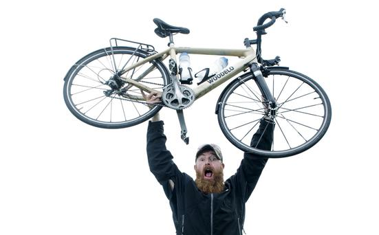 Pictured is Mark Graham in Kinsale after completing his epic Wild Atlantic Way adventure by wooden bike. Photo: Gerard McCarthy