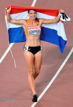Netherlands' Dafne Schippers celebrates winning the final of the women's 200 metres with a championship record of 21.63 secondsyears.