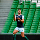 Conor Murray keeps his eyes on the ball during yesterday's captain's run at the Aviva Stadium