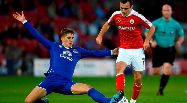 In-demand John Stones of Everton tackles Barnsley's Josh Scowen during their midweek League Cup clash