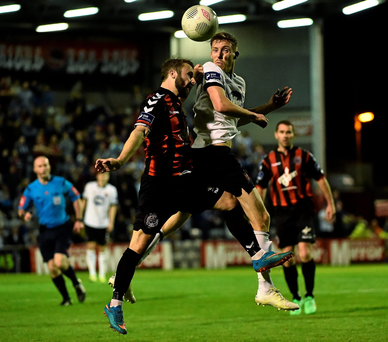 Dundalk's David McMillan in action against Dylan Hayes of Bohemians