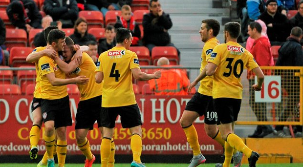 Derry City players celebrate after Ciaran O'Connor scored their side's first goal of the game at Richmond Park, Dublin