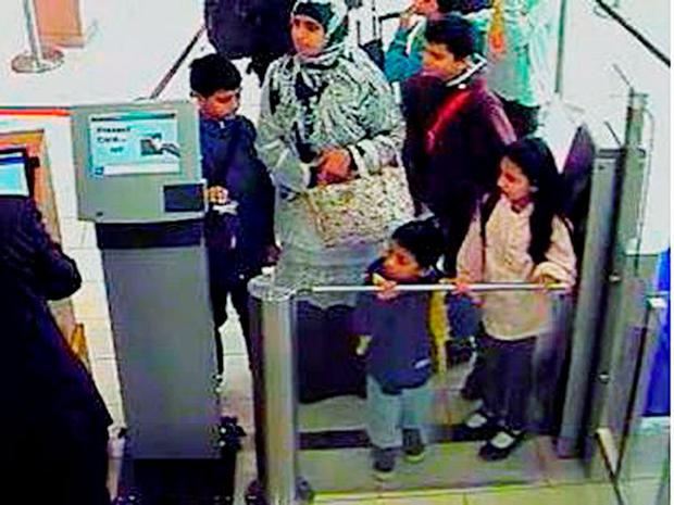 Handout still dated 25/08/15 taken from CCTV issued by the Metropolitan Police of Zahera Tariq, 33, with her children Muhammad, 12, Amaar, 11, Safiyyah, nine and Aadid, four, at London City Airport.