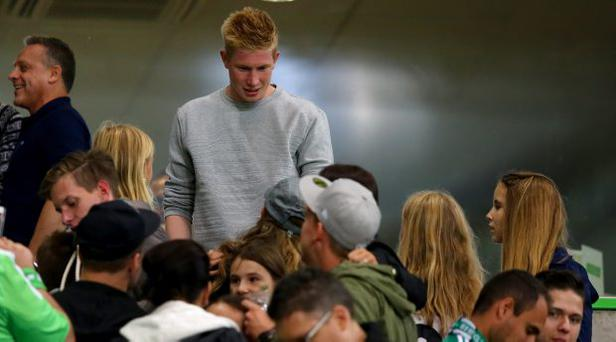 Kevin de Bruyne of Wolfburg is seen with fans during the Bundesliga match between VfL Wolfsburg and FC Schalke 04 at Volkswagen Arena on August 28, 2015 in Wolfsburg, Germany. (Photo by Martin Rose/Bongarts/Getty Images)