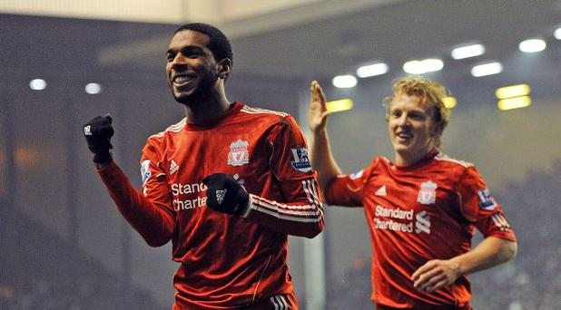 Ryan Babel (L) celebrates during his time at Liverpool