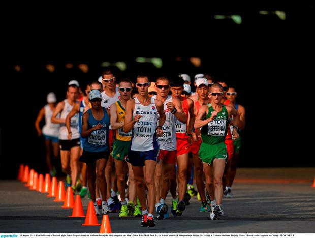 Rob Heffernan of Ireland, right, leads the pack from the stadium during the early stages of the Men's 50km Race Walk final