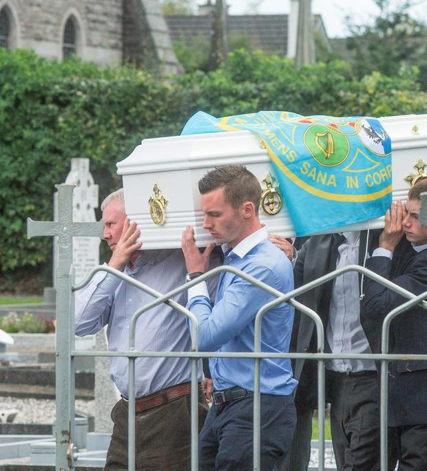 29/8/2015: Family and friends carried the coffin from the church to the graveside at the funeral of Donal English-Hayden in Rathoe. Photo: Pat Moore.