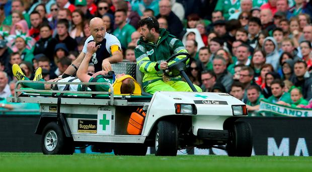 Ireland's Keith Earls gives a thumbs up to the crowd as he's taken off injured during the World Cup Warm Up Match at the Aviva Stadium, Dublin. PRESS ASSOCIATION Photo. Picture date: Saturday August 29, 2015. See PA story RUGBYU Ireland. Photo credit should read: Niall Carson/PA Wire. RESTRICTIONS: Editorial use only. No commercial or promotional use without prior consent from IRFU. No alterations or doctoring. For further information please call +44 (0)115 8447447.