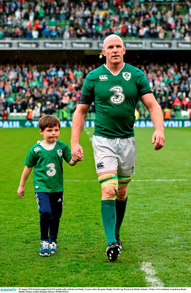 Ireland captain Paul O'Connell walks with his son Paddy, 5 years, after the game. Rugby World Cup Warm-Up Match, Ireland v Wales, Aviva Stadium, Lansdowne Road, Dublin. Picture credit: Brendan Moran / SPORTSFILE
