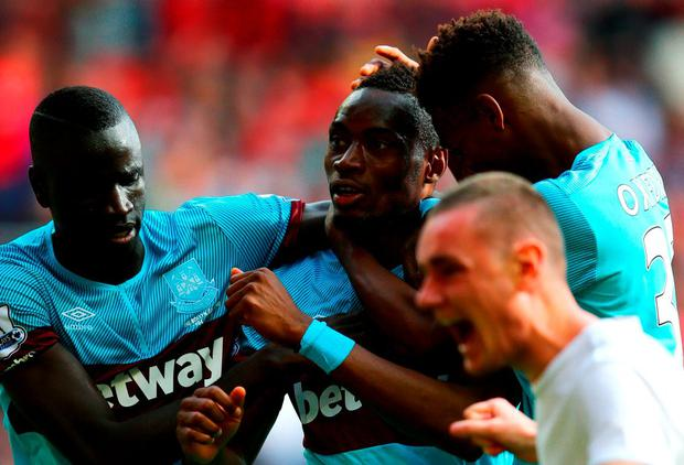 LIVERPOOL, ENGLAND - AUGUST 29: Diafra Sakho (C) of West Ham United celebrates scoring his team's third goal with his team mates Cheikhou Kouyate (L) and Reece Oxford (R) during the Barclays Premier League match between Liverpool and West Ham United at Anfield on August 29, 2015 in Liverpool, England. (Photo by Clive Mason/Getty Images)