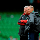 Ireland head coach Joe Schmidt speaks with Wales head coach Warren Gatland