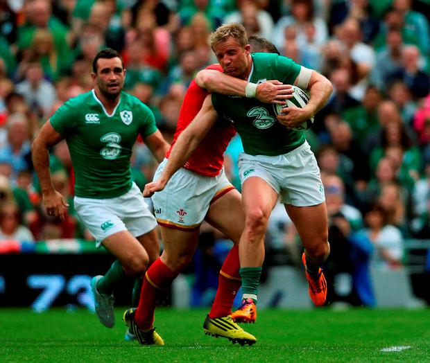 Ireland's Luke Fitzgerald is tackled by Wales' Rhys Webb during the World Cup Warm Up Match at the Aviva Stadium, Dublin. PRESS ASSOCIATION Photo. Picture date: Saturday August 29, 2015. See PA story RUGBYU Ireland. Photo credit should read: Brian Lawless/PA Wire. RESTRICTIONS: Editorial use only. No commercial or promotional use without prior consent from IRFU. No alterations or doctoring. For further information please call +44 (0)115 8447447.