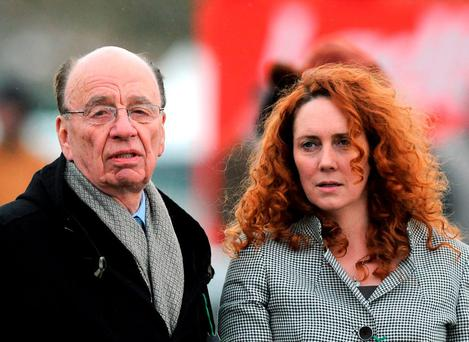 File photo dated 18/03/10 of Rupert Murdoch and Rebekah Brooks as top executives at his publishing company could face corporate criminal charges over phone hacking. Barry Batchelor/PA Wire