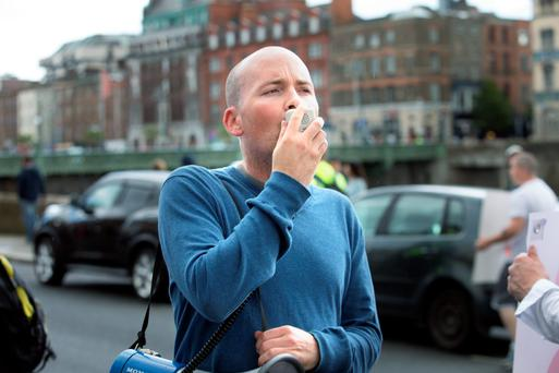 Paul Murphy TD leads the chanting as thousands of people march along Dublin's Quays during and Anti Water Charges. Photo: Tony Gavin